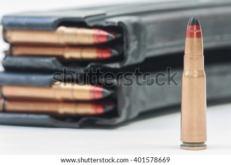 rifle bullet and ammunition pouch on white background:Choose a focal point ammunition. - stock photo