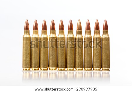 Rifle bullets in a row isolated on white background. - stock photo