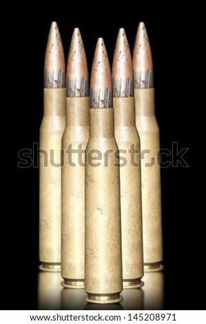 Rifle frayed bullets close-up on black backgrounds - stock photo