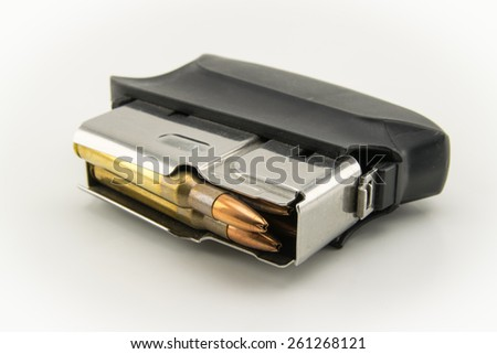 rifle loader with golden ammunition - stock photo