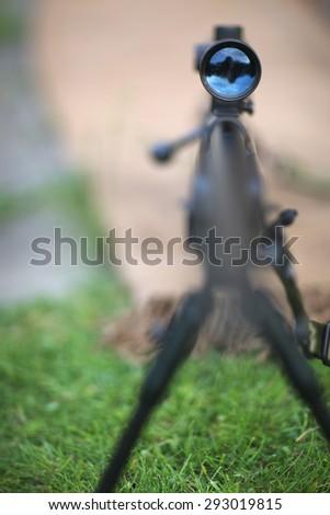 Rifle scope in focus - stock photo