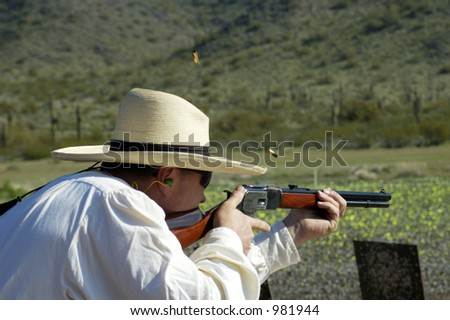 "Rifle shooting competition at a ""cowboy action shoot"". - stock photo"