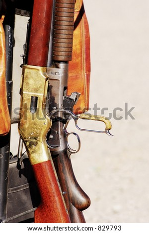 Rifles and shotguns at a cowboy shoot competition. - stock photo