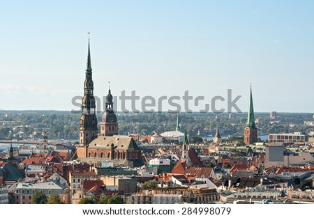 Riga, a top view of St. Peter's Church and dome Cathedral - stock photo