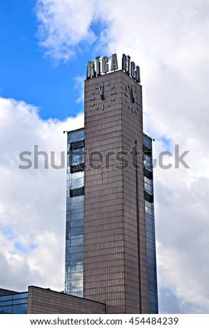 Riga central station clock tower - stock photo