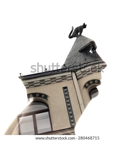 "Riga, double exposure: a male profile and a fragment of ""House with black cats"", well-known outside Latvia. Silhouettes of animals used in its design, many considered the unofficial symbol of Riga. - stock photo"