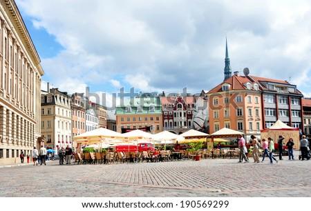 RIGA, LATVIA - AUGUST 11: Cobbled city square on August 11, 2012 in Riga, Latvia. - stock photo