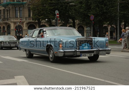 RIGA, LATVIA - AUGUST 16: Parade of old cars on the Riga City Festival in Riga on August 16, 2014 in Latvia.