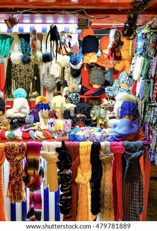 Riga, Latvia - December 24, 2015: One of the colorful stall at the Riga Christmas Market in Latvia. At this stall people can buy different warm clothes such as gloves, hats, scarfs and socks.