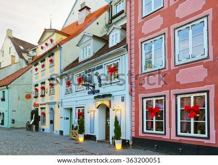 RIGA, LATVIA - DECEMBER 25, 2011: Street view at the market place in the Old city of Riga in Latvia at Christmas