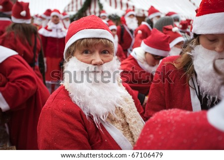 RIGA, LATVIA - DECEMBER 12: Unidentified participants of the third annual Santas Fun Run & Walk on Dec. 12, 2010 in Riga, Latvia.