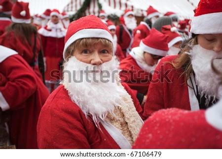 RIGA, LATVIA - DECEMBER 12: Unidentified participants of the third annual Santas Fun Run & Walk on Dec. 12, 2010 in Riga, Latvia. - stock photo