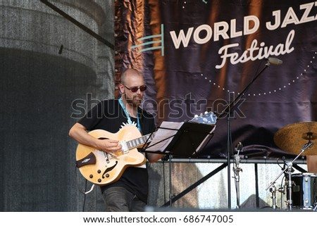 "RIGA, LATVIA - JUL 27: Jazz musician Svens Vilsons from Latvia plays guitar at free public concert within ""World Jazz Festival"" on Jul 27, 2017 in Riga, Latvia. Festival is held annually"
