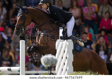RIGA, LATVIA - JULY 31: Aleksandra WIECKOWSKA jumps over the obstacle with horse GOLDIK GIRL, World Cup competition, Grand Prix Riga 2016, CSI2*-W, CSIYH1* on JULY 31, 2016 in Kleisti sports center