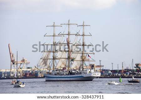 RIGA, LATVIA - JULY 28, 2013: Large sailing ship Mir leaving the port of Riga during the Regatta The Tall Ships Races 2013 Parade of sail. It is Full rigged training ship from Russia - stock photo