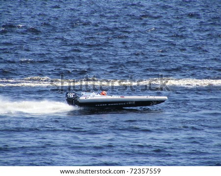 "RIGA, LATVIA - 24 JULY: Rigid Inflatable Boat from Russia competes in the race ""Six hours of Riga"" in Riga, Latvia, on july 24, 2010."