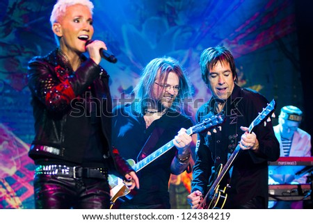 RIGA, LATVIA - MARCH 16: Swedish pop rock band ROXETTE with Marie Fredriksson during their concert at Arena Riga on March 16, 2011 in Riga, Latvia. - stock photo
