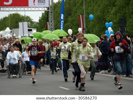 RIGA, LATVIA - MAY 17: Disabled people participate in the 2009 Nordea Rigas Marathons May 17, 2009 in Riga, Latvia. - stock photo