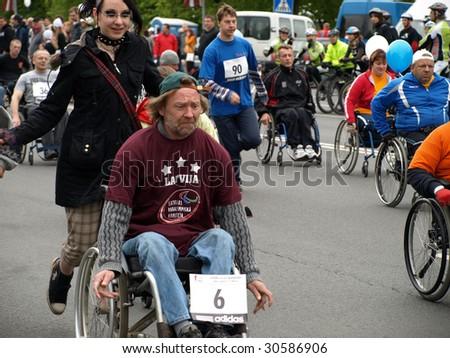 RIGA, LATVIA - MAY 17: Disabled people participate in the 2009 Nordea Rigas Marathons May 17, 2009 in Riga, Latvia. - stock photo