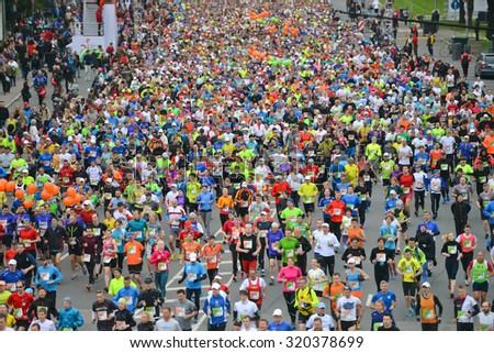 Riga, Latvia - May 17, 2015: Lattelecom Riga Marathon with 25 931 participants from 69 countries. Marathon and half marathon distance start. - stock photo