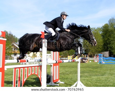 RIGA, LATVIA - MAY 10: Latvian rider Kristaps Neretnieks show jumps at the Latvian national championship in show jumping on may 10, 2008. - stock photo
