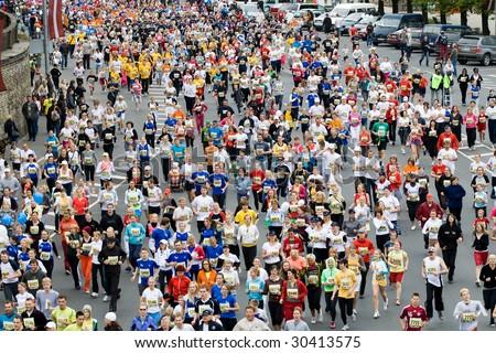 RIGA, LATVIA - MAY 17 : Marathon runners in action at the Riga International Marathon on May 17, 2009 in Riga. - stock photo