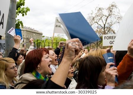 RIGA, LATVIA, MAY 16, 2009: Protestors against Baltic Gay Pride 2009 in Riga, Latvia, May 16, 2009. - stock photo