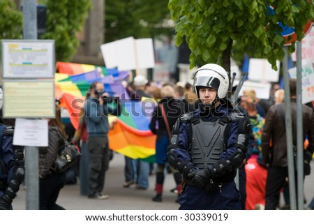 RIGA, LATVIA, MAY 16, 2009: Riot Police stands to separate Protesters against participants of Baltic Gay Pride 2009 in Riga, Latvia, May 16, 2009. - stock photo