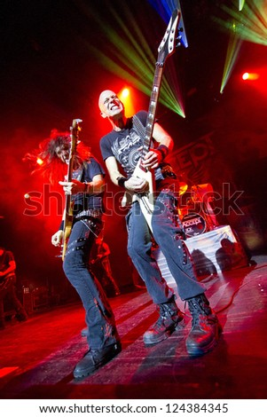 RIGA, LATVIA - NOV 11: Wolf Hoffmann and Peter Baltes from German heavy metal band ACCEPT during show at Palladium on November 11, 2012 in Riga, Latvia. - stock photo