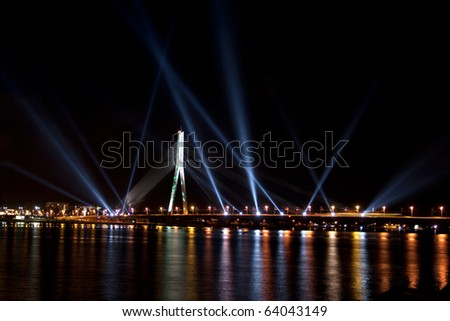 RIGA, LATVIA - NOVEMBER 16: The first light festival Staro Riga (Beaming Riga) celebrating 90th anniversary of independence, 16 November, 2008 - stock photo