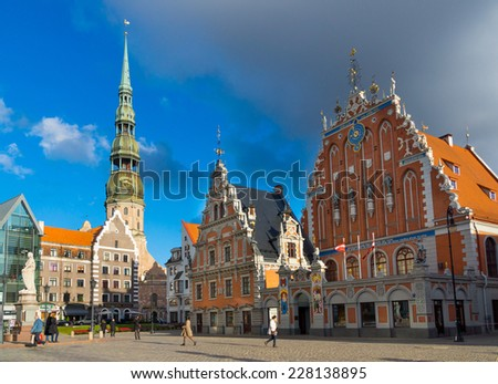 RIGA, LATVIA - SEPTEMBER 30: House of the Blackheads and St. Peter's Church at daytime on September 30, 2014 in Riga, Latvia - stock photo
