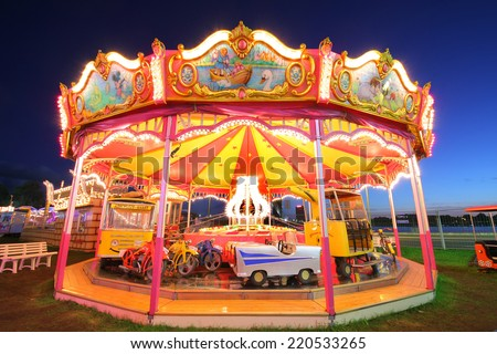 Riga, Latvia- September 27, 2014: Merry-Go-Round (carousel) illuminated at night.  Located in the centre of Riga, Latvia on September 27, 2014. Riga is European Capital of Culture 2014. - stock photo