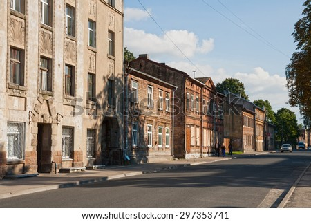 RIGA, LATVIA - SEPTEMBER 03, 2014 - Street with old wooden houses in the city center - stock photo