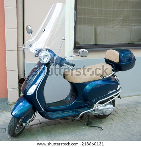 RIGA, LATVIA - SEPTEMBER 8: Vespa scooter (motoroler) on September 8, 2014 in Riga, Latvia. Vespa is an Italian brand of scooter manufactured by Piaggio. The name means wasp in Italian. - stock photo