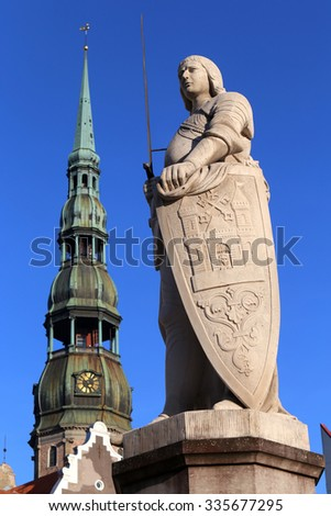 Riga,Latvia-8th March:statue of Roland in the town hall.On background the church of St Peter.Riga,Latvia on 8th march 2015