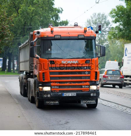 RIGA - SEP 8: Scania 114G V8 530 truck on a road on Sep. 8, 2014 in Riga, Latvia. Scania is a major Swedish automotive manufacturer of commercial vehicles - specifically heavy trucks and buses. - stock photo