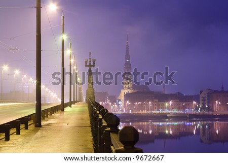 riga stone bridge in the night - stock photo