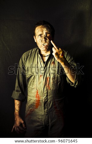 Rigamortis Sets Into The Middle Finger On The Hand Of A Zombie Showing A Unfriendly Gesture Of Disrespect In A Message From Beyond The Tomb - stock photo