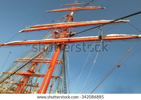 Rigging equipment and large four masted sailing vessel - stock photo