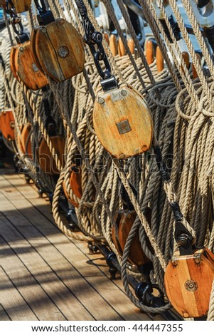 Rigging of a sailing ship consisting of ropes and pulleys - stock photo