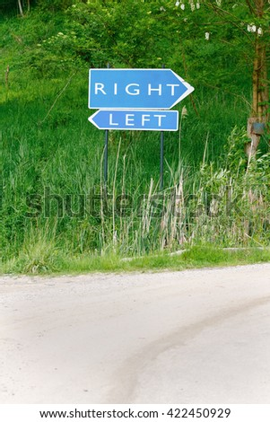 Right and left words written on blue roadsign at crossroads in the nature - stock photo