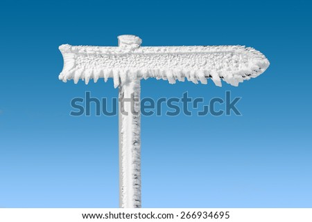 right blank arrow sign covered by frost - stock photo