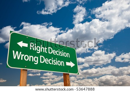 Right Decision, Wrong Decision Green Road Sign with Copy Room Over The Dramatic Clouds and Sky.