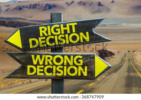 Right Decision - Wrong Decision signpost in a desert background - stock photo