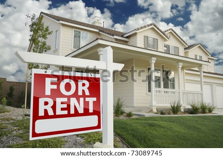 Right Facing Red For Rent Real Estate Sign in Front of Beautiful House. - stock photo