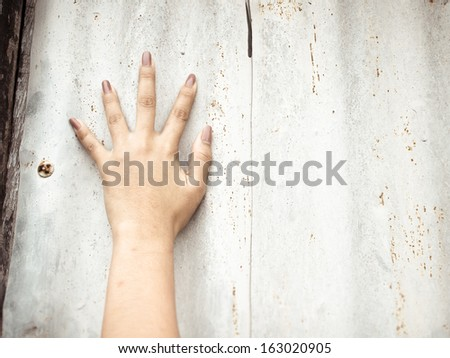 Right hand calling for help on grunge background - stock photo