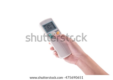 Right hand holding remote air conditioner turn up to 27 celcius with air conditioner.