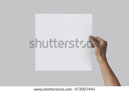 Right hand holding square paper in the right hand. Leaflet presentation. Pamphlet hand man. Man show offset paper. Sheet template. Book in hands. Booklet folding design. Fold paper sheet display read.