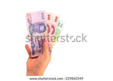 right hand holding thailand paper currency from below isolated on white