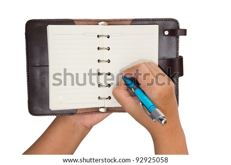 Right hand take a note on Brown leather notebook. isolated on white background